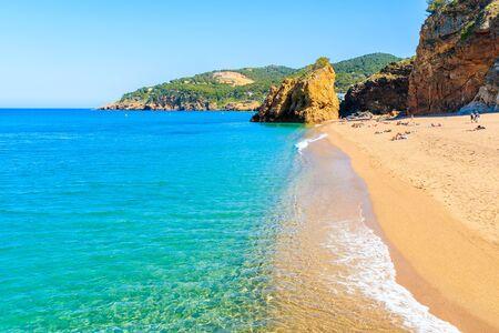 Sea wave on Cala Moreta beach and view of rocks, Costa Brava, Catalonia, Spain