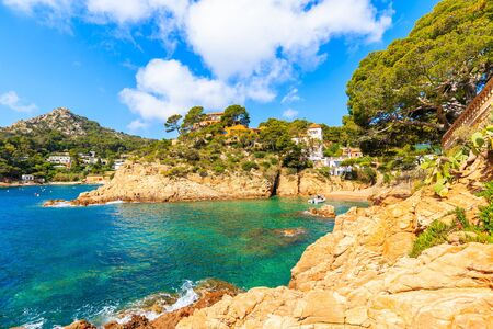 View of small bay with beach in Cala Fornells fishing village, Costa Brava, Catalonia, Spain