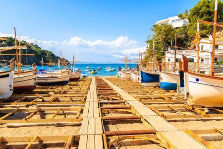 Fishing boats on beach in beautiful Sa Riera village, Costa Brava, Catalonia, Spain Фото со стока - 130816111