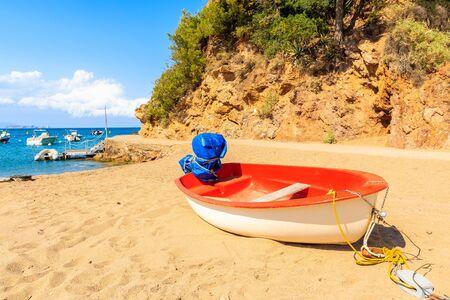 Fishing boat on beach in beautiful Sa Riera village, Costa Brava, Catalonia, Spain