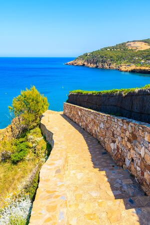 Walking path along coast near beautiful Sa Riera village, Costa Brava, Catalonia, Spain Фото со стока - 130816156