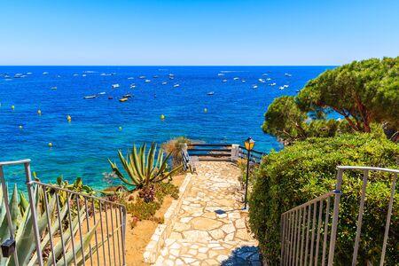Walkway on beautiful coast in fishing village Calella de Palafrugell, Costa Brava, Catalonia, Spain