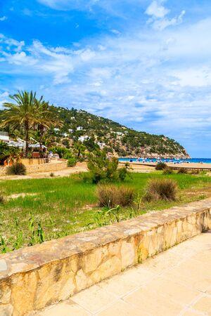 Coastal walkway to beach in beautiful bay of Cala Sant Vicent, Ibiza island, Spain