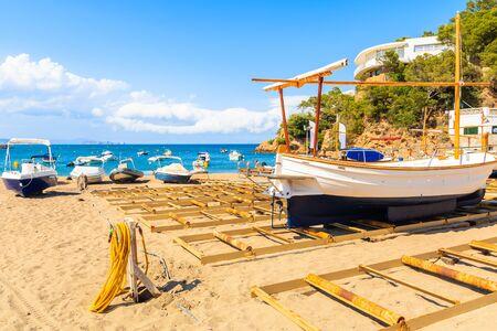 Fishing boats on beach in beautiful Sa Riera village, Costa Brava, Catalonia, Spain