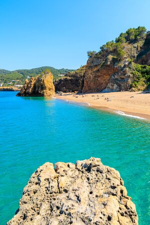 Azure blue sea water at Cala Moreta beach and view of rocks, Costa Brava, Catalonia, Spain Фото со стока