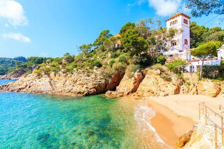 Small beach with castle in Cala Fornells fishing village, Costa Brava, Catalonia, Spain Фото со стока - 130816136