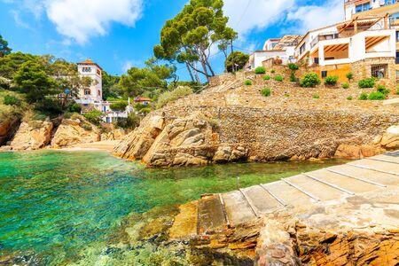Small beach in port of Cala Fornells fishing village, Costa Brava, Catalonia, Spain