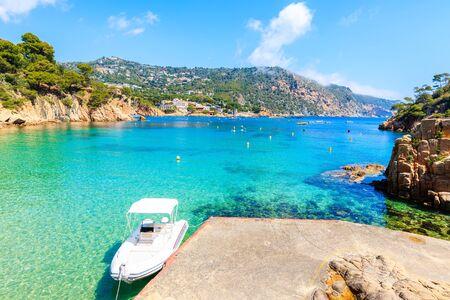 Boat anchoring on beautiful Aiguablava beach, Costa Brava, Catalonia, Spain
