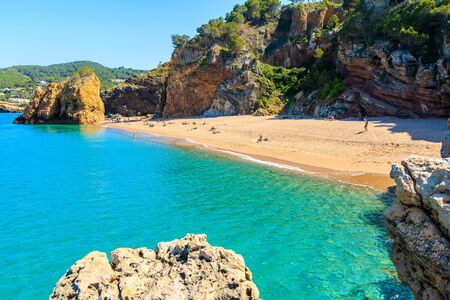Azure blue sea water at Cala Moreta beach and view of rocks, Costa Brava, Catalonia, Spain Фото со стока - 130816070