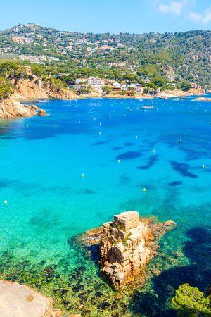 Rock in sea on beautiful Aiguablava beach, Costa Brava, Catalonia, Spain