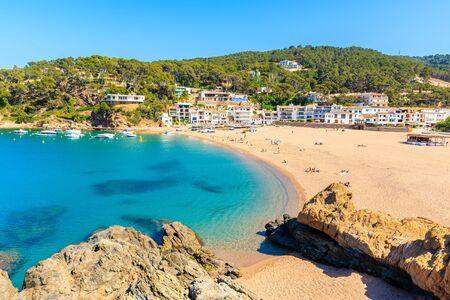 View of Sa Riera beach and fishing village in background, Costa Brava, Catalonia, Spain Фото со стока
