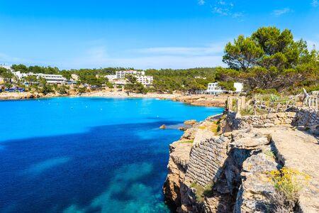 Coastal path along azure sea in beautiful bay of Cala Portinatx, Ibiza island, Spain