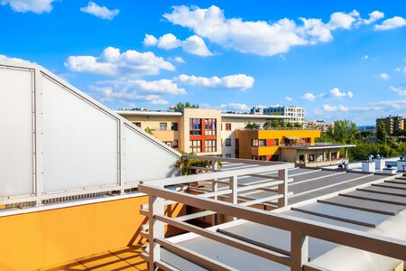 Terrace of new city apartment on sunny day with beautiful blue sky and white clouds in Krakow, Poland