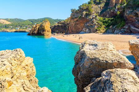Azure blue sea water at Cala Moreta beach and view of rocks, Costa Brava, Catalonia, Spain Фото со стока - 130815992