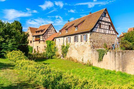 Old traditional houses in Kientzheim village on Alsatian Wine Route, France