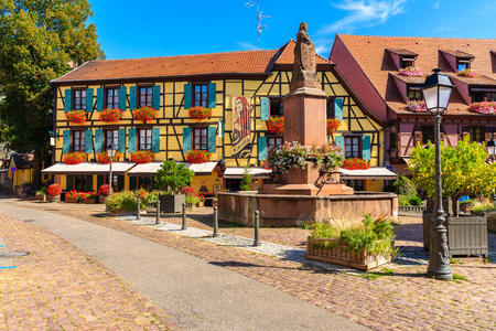 RIBEAUVILLE, FRANCE - SEP 18, 2019: Beautiful historic houses in old part of Ribeauville village which is located on famous wine route in Alsace region of France.