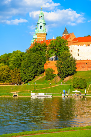 View of Wawel castle on bank of Vistula river in Krakow, Poland Редакционное