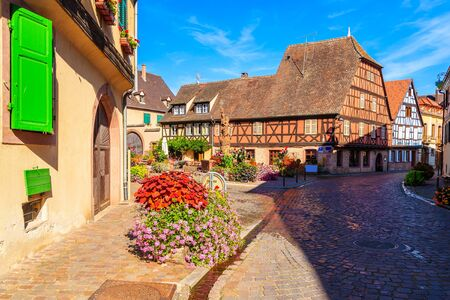 Beautiful traditional colorful houses in picturesque Kientzheim village, Alsace wine region, France