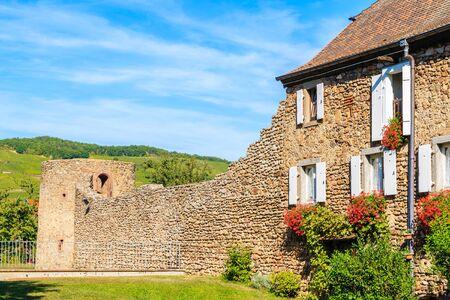 Beautiful typical stone house facade in picturesque Kientzheim village, Alsace wine region, France