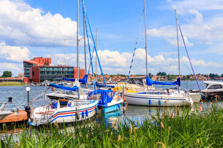 Sailing boats on lake shore, Mikolajki, Mazury Lake District, Poland