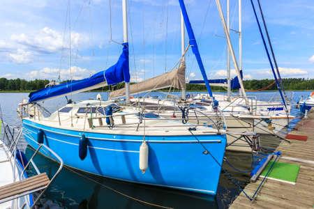 Sailing boats on lake shore in Wygryny village marina, Mazury Lake District, Poland Zdjęcie Seryjne