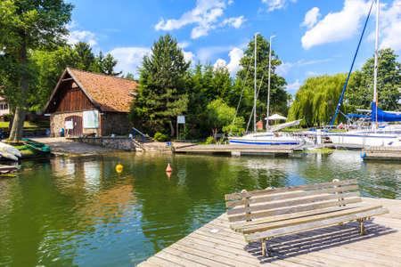 Pier in Wierzba sailing port on Lake Beldany on summer sunny day, Masurian Lakes, Poland