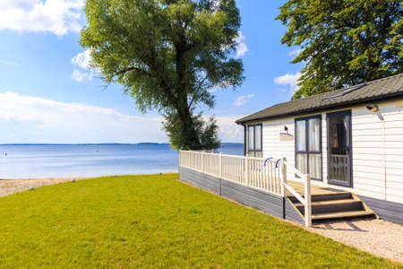 Camping house in sailing port Nowe Guty on Lake Sniardwy on summer sunny day, Masurian Lakes, Poland