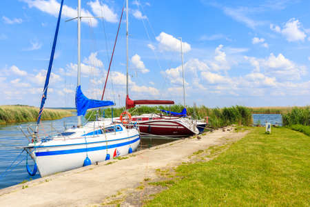 Boats anchoring in Popielno sailing port on Lake Sniardwy on summer sunny day, Masurian Lakes, Poland