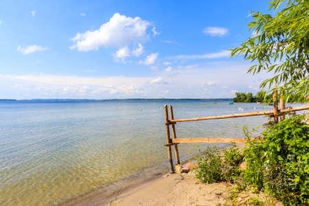 Beautiful sandy beach in sailing port Nowe Guty on Lake Sniardwy on summer sunny day,  Masurian Lakes, Poland