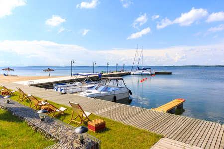 Yacht boats at pier in sailing port Nowe Guty on Lake Sniardwy on summer sunny day,  Masurian Lakes, Poland Zdjęcie Seryjne