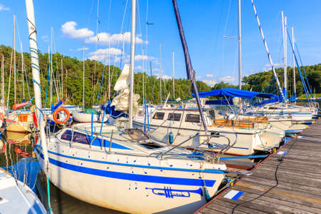 Sailing boats mooring in small port in Ruciane Nida, Masurian Lakes, Poland