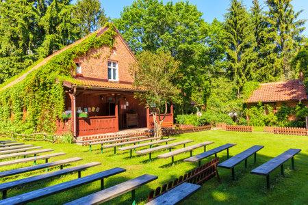 PUSZCZA PISKA, POLAND - JUN 25, 2020:  Forester house in Pranie village near lake Nidzkie. This house was home to famous Polish writer Konstanty Ildefons Galczynski, Mazury Lake District.