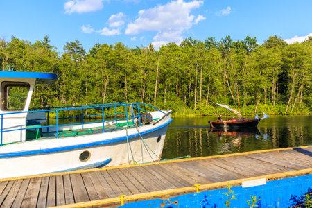 LAKE BELDANY, POLAND - JUN 28, 2020: Sailing boat on Lake Beldany near Ruciane Nida, Masurian Lakes, Poland. This region is popular holiday destination for people of Warsaw city.