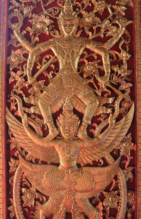 Large antique wooden door behind the sanctuary in Wat Phra That Doi Kham temple inChiangmai the north of Thailand. Is one popular tourist destination. Zdjęcie Seryjne