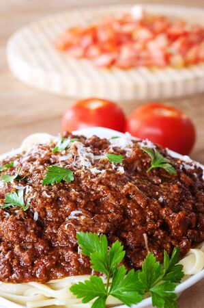 bowl of spaghetti bolognese with tomatoes