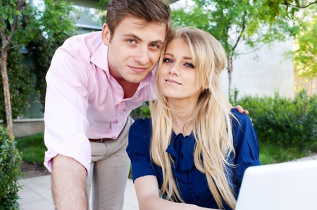 portrait of a happy young professional couple with laptop outside Stock Photo - 13101578