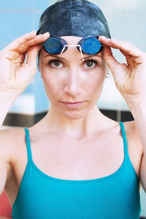 athetlic female swimmer with goggle and swimming cap
