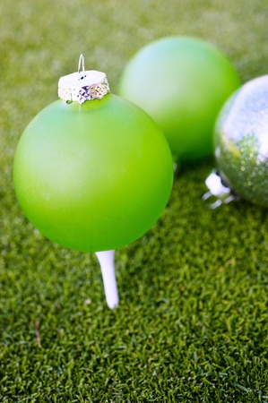 christmas golf: Green christmas ornaments on a golf course