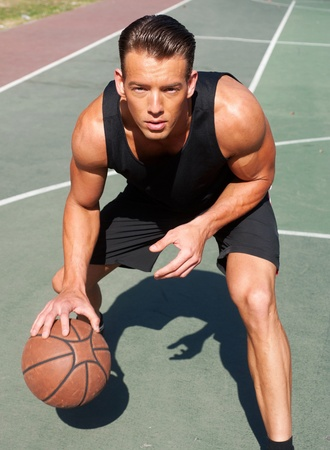 portrait of a male basketball player on basketball court photo