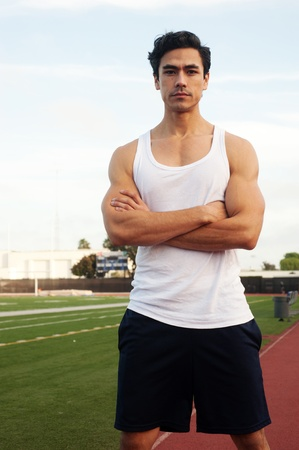 latino man: handsome, young latino athlete on athletic field Stock Photo