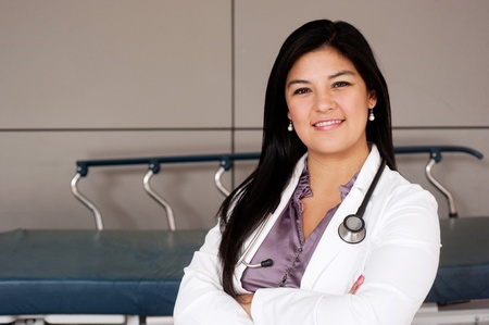 Portrait of young female doctor standing outside photo