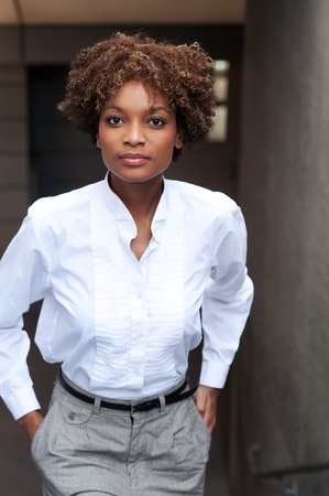 pretty African American executive standin outside with hands in pocket Stock Photo - 13138481