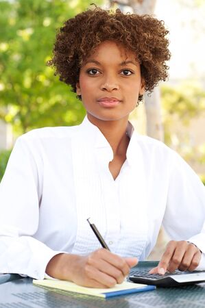 pretty African American executive sitting outside Stock Photo - 13139248