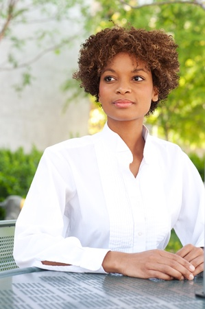 pretty African American executive sitting outside Stock Photo - 13139284