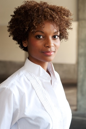 closeup of pretty African American executive standing outside photo
