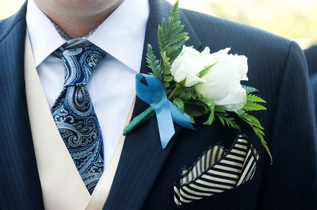 closeup of a ceremony suit with a flower