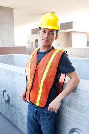 portrait of a young asian construction worker standing outside Stock Photo
