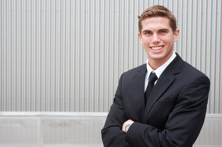 portrait of a young handsome businessman shot on location Stock Photo