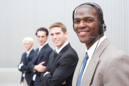 portrait of an African American businessman with coworkers in background Stock Photo - 13675728