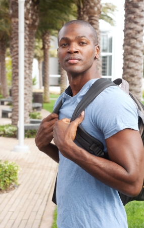african student: portrait of an African American college student on campus